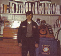 Terry as head auto mechanic and manager in 1972